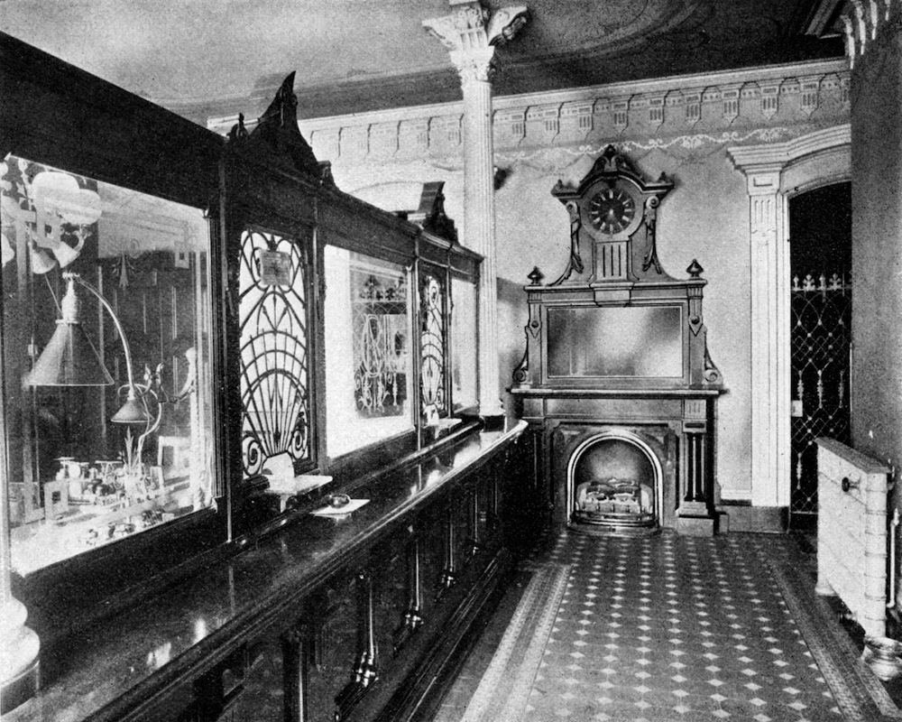 Interior of the National Bank of Commerce, showing the cashier's window.