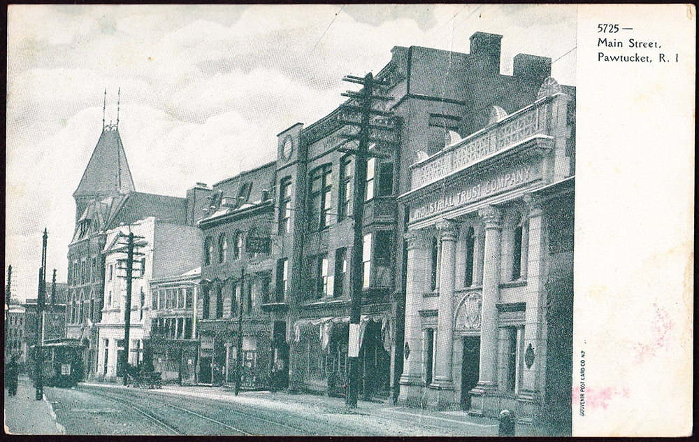 The First National Bank of Pawtucket and the Pacific National Bank were consolidated into a single branch representing the Industrial Trust Company in Pawtucket. Seen here at right, early 1900s, just down the street from Slater National Bank's headquarters.