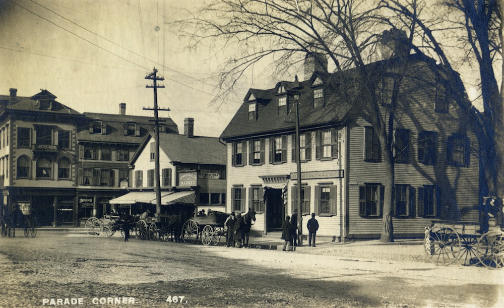 A 19th century photo of the  Newport National Bank's historic home on Washington Square. Also visible are the Ambrose Dining Rooms and Coggeshall's Market. © Newport Historical Society. Reprinted with permission.