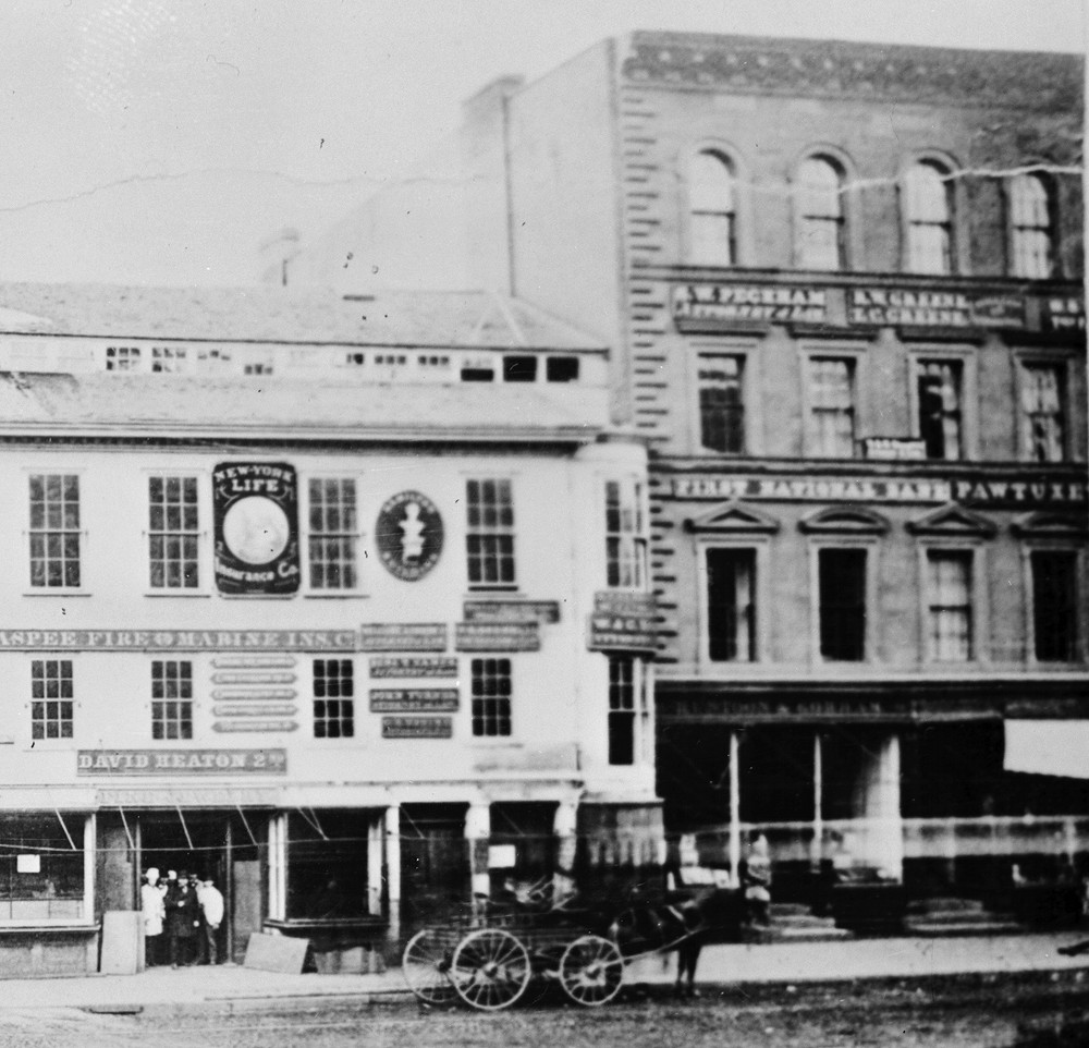 "The Pawtuxet Bank's home on Westminster Street was located on the second floor of the building at right. The ""Pawtuxet"" of the bank's sign is visible here."
