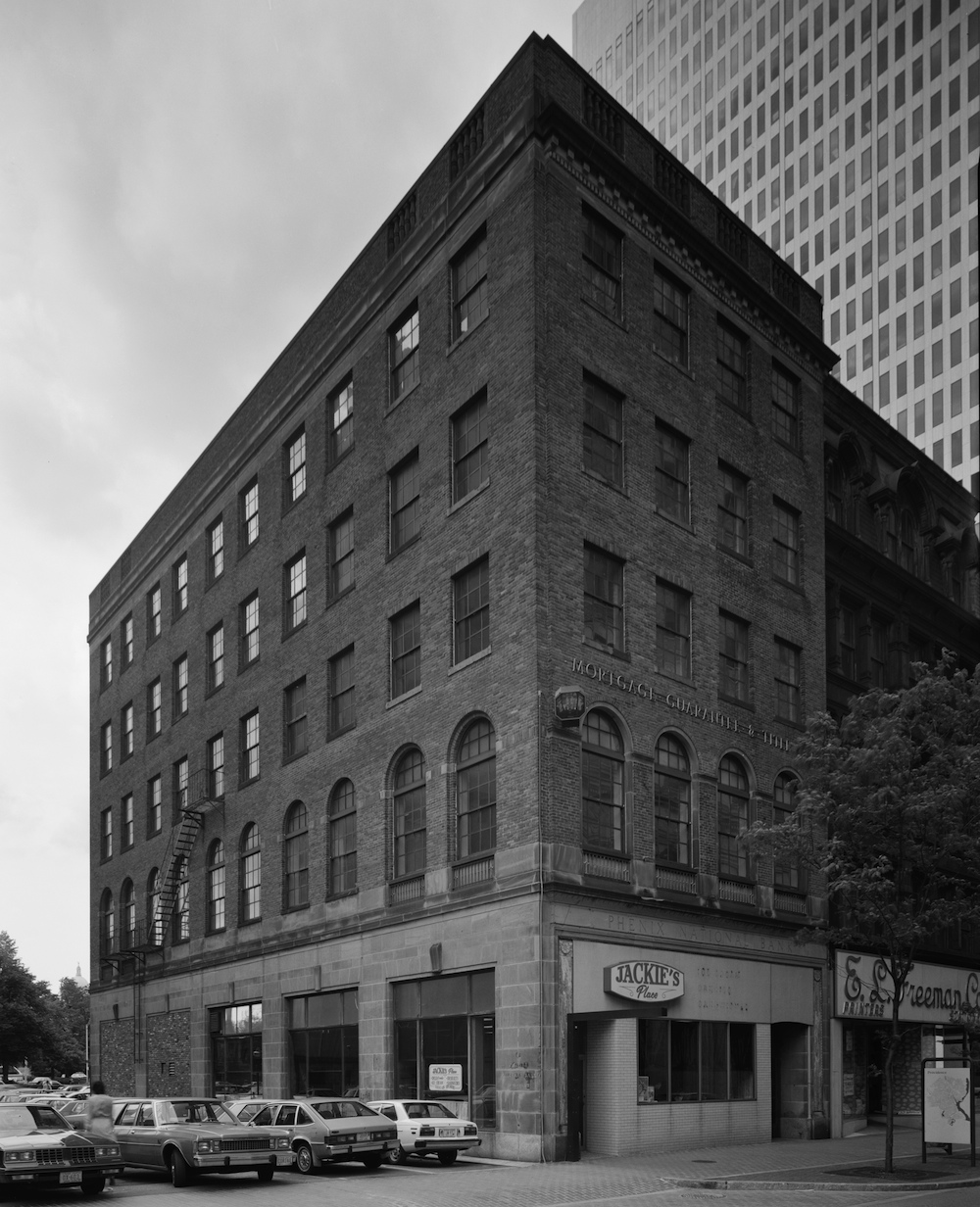 Former offices of the  Phenix National Bank at 85-89 Westminster Street, in a circa 1970s photograph (from the Library of Congress). The bank's name is visible above the first floor, on the right side of this image.