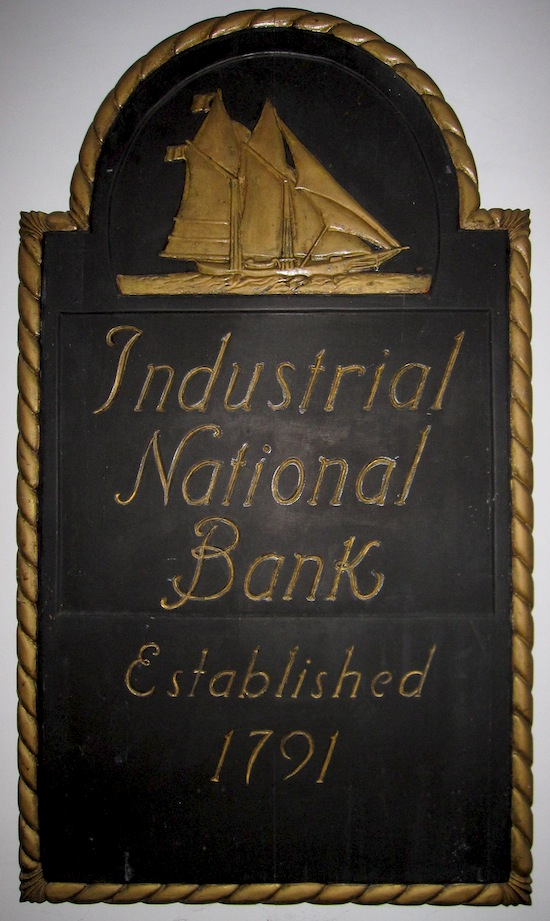 Sign for an Industrial National Bank branch.